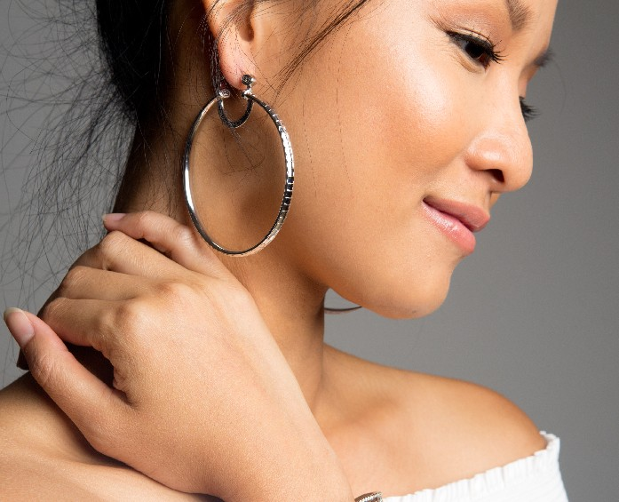 Asian woman wearing earrings from the Simone Smith Collection